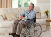 Senior man in his wheelchair — Stock Photo