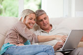 Couple looking at their laptop — Stock Photo