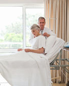 Senior doctor taking the heartbeat of his patient — Stock Photo