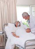 Senior doctor with his sick patient — Stock Photo
