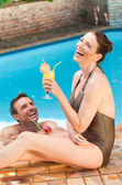 Smiling couple drinking cocktails — Stock Photo