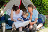 Family camping in the garden — Stock Photo