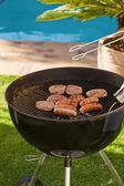 A barbecue in the garden — Stock Photo