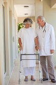 Doctor walking with his patient — Stock Photo