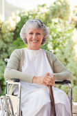 Retired woman with her walking stick — Stock Photo