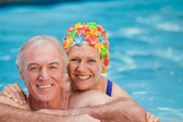 Happy mature couple in the swimming pool — Stock Photo