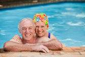 Happy mature couple in the swimming pool — Photo