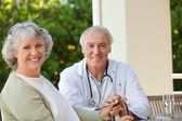 Senior doctor talking with his mature patient — Stock Photo