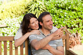 Glad couple hugging in the garden — Stock Photo