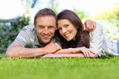Couple lying down in the garden — Stock Photo