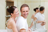 Couple hugging in the bathroom — Stock Photo