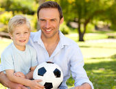 Father with his son after a football game — Foto Stock