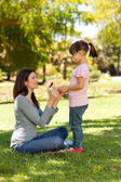Joyful mother with her daughter in the park — Stock Photo