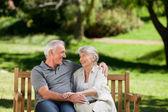 Senior couple sitting on a bench — Stock Photo