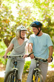 Couple with their bikes in the wood — Stock Photo