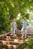 Couple running in the wood — Foto Stock