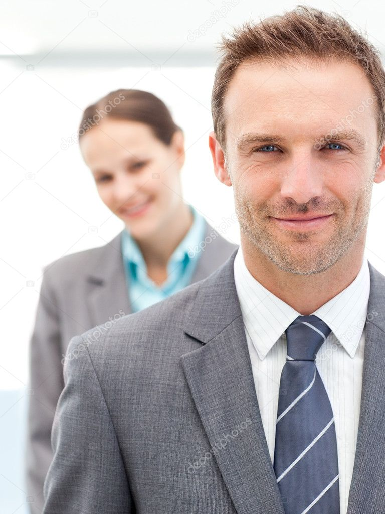 Confident businesswoman and businessman posing together in line at work  Stock Photo #10841205