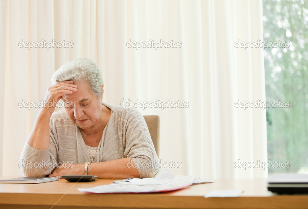 Retired woman calculating her domestic bills  Stock Photo #10846661