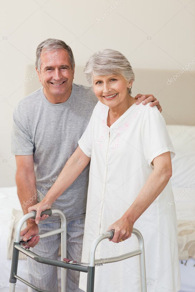 Man helping his wife to walk — Stock Photo #10847589