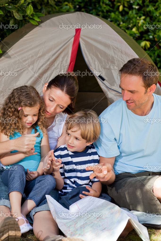 Adorable family camping in the garden — Stock Photo #10848146