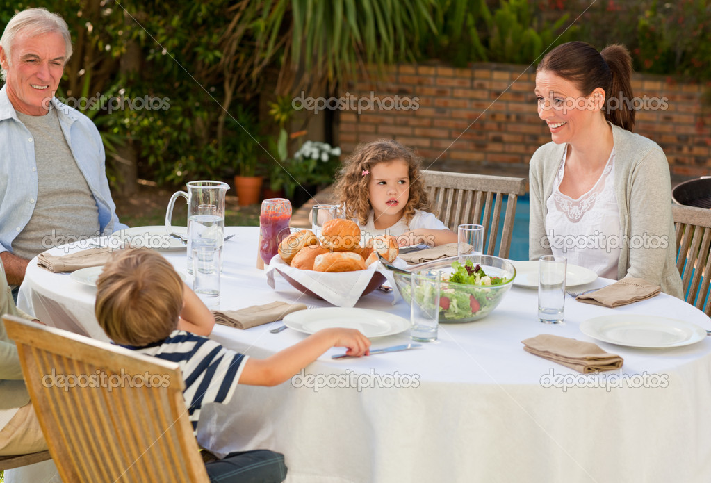 Family eating in the garden  Stock Photo #10848215