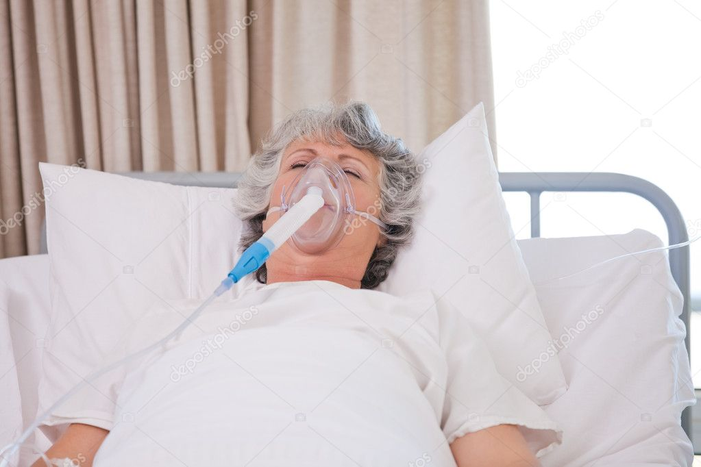 Senior woman with her respirator  Stock Photo #10849003