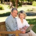 Senior couple working on their laptop — Stock Photo