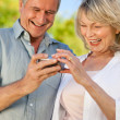 Mature couple looking at their camera — Stock Photo