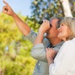 Couple looking at the sky with their binoculars — Stock Photo