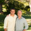 Father with his son looking at the camera in the park — Stock Photo #10850496