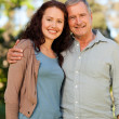 Woman with her father-in-law in the park — Stock Photo