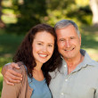 Stock Photo: Womwith her father-in-law in park