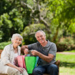 Stock Photo: Retired couple with shopping bags