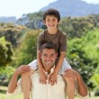 Mgiving son piggyback — Stock Photo #10850718