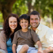 Joyful family sitting in the garden — Stock Photo #10850789
