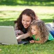 Mother and her daughter working on the laptop — Stock Photo #10850886