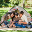 Joyful family camping - Stock Photo