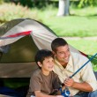 Son fishing with his father — Stock Photo #10850958