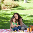 Mother and her daughter picnicking — Stock Photo #10850981