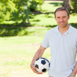 Handsome man with a ball — Stock Photo