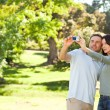 Royalty-Free Stock Photo: Couple taking a photo of themselves in the park