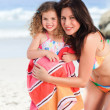 Mother with her daughter in a towel — Stock Photo