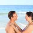 Lovely couple hugging on the beach — Stock Photo