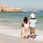 Joyful family at the beach — Stock Photo
