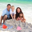 Radiant family at the beach — Stock Photo
