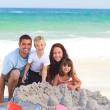 Radiant family at the beach — Stock Photo