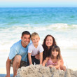 Radiant family at the beach — Stock Photo #10852595