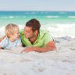 Happy father with his son at the beach — Stock Photo