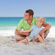 Attentive father with his son at the beach — Stock Photo #10852628