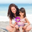 Little girl and her mother with a windmill — Stock Photo